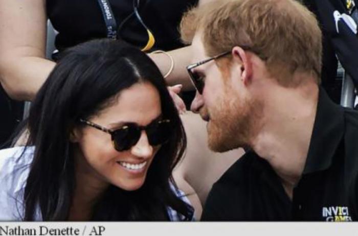 """Prințul Harry """"i-a furat"""" un sărut iubitei sale, Meghan Markle, la închiderea Jocurilor Paralimpice Invictus"""
