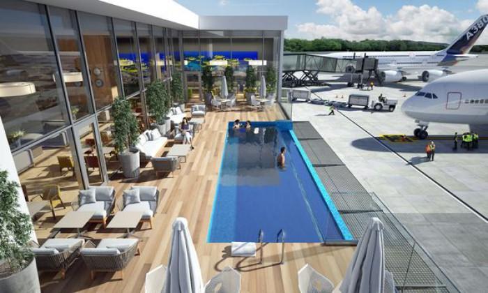 Un nou aeroport unde poţi aştepta avionul într-o piscină aflată la doar câţiva metri de aeronavele garate, se deschide curând