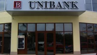 Doi foști angajați ai UNIBANK riscă șapte ani de închisoare, după ce au eliberat patru credite, în valoare totală de 16 milioane de dolari SUA și 15 milioane de euro