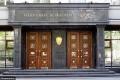 (foto) Sute de mii de dolari, descoperiți în birourile a doi oficiali din Procuratura Generală de la Kiev