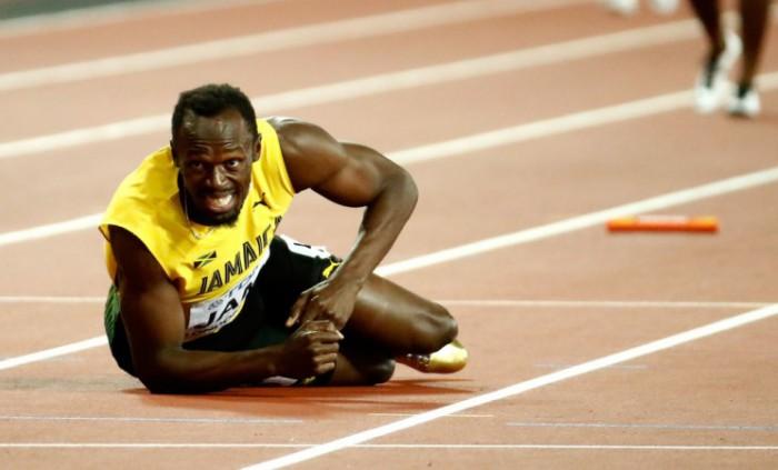 (video) Ghinion pentru Usain Bolt! Jamaicanul s-a accidentat în timpul ultimei sale curse din carieră